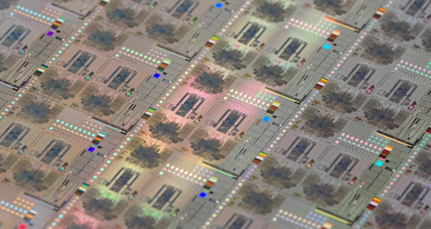 A large digital integrated circuit posed on top of a wafer containing several other digital integrated circuits